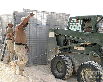 U.s. Army Soldiers Use A Bobcat S150 Art Print by Stocktrek Images