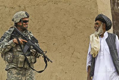 U.s. Army Specialist Talks To An Afghan Art Print by Stocktrek Images