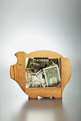 Us Dollar Banknotes In Piggy Bank Art Print by Yuji Sakai