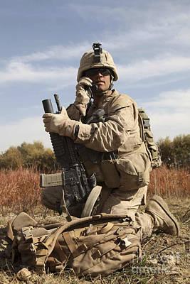 Talking On The Phone Photograph - U.s. Marine Communicates by Stocktrek Images