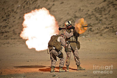 Rpg Photograph - U.s. Marine Fires A Rpg-7 Grenade by Terry Moore