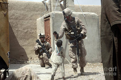 U.s. Marine Gives An Afghan Child Art Print by Stocktrek Images