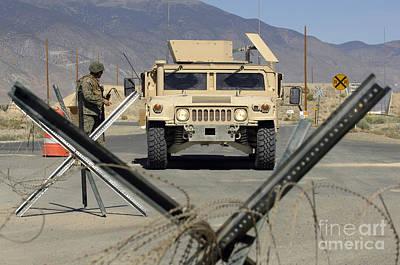 Roadblock Photograph - U.s. Marine Guards The Gate by Stocktrek Images