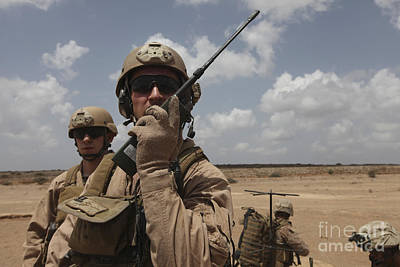 U.s. Marine Uses A Radio In Djibouti Art Print by Stocktrek Images