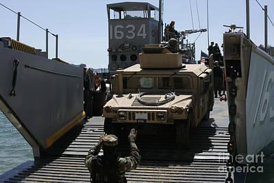 U.s. Marines Load An M1114 Humvee Onto Art Print by Stocktrek Images