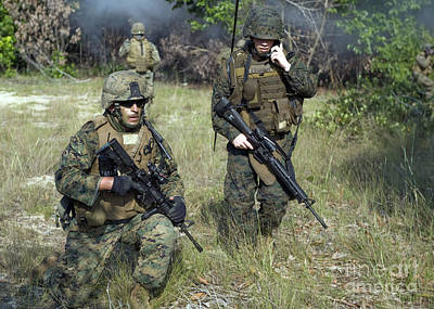Talking On The Phone Photograph - U.s. Marines Secure A Perimeter by Stocktrek Images