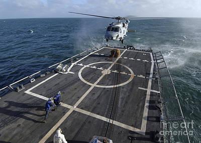 U.s. Navy Sailors Prepare To Attach Art Print by Stocktrek Images