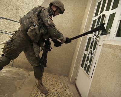 Us Soldier Breaks Down A Door Art Print