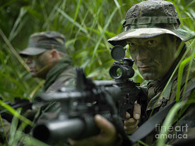 Photograph - U.s. Special Forces Soldiers Patrol by Tom Weber