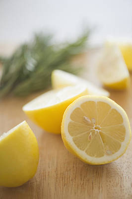 Y120907 Photograph - Usa, New Jersey, Jersey City, Lemon On Chopping Board by Jamie Grill