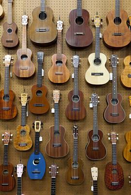 Ukelele Photograph - Various Guitars & Ukuleles Hanging From Wall by Lisa Romerein