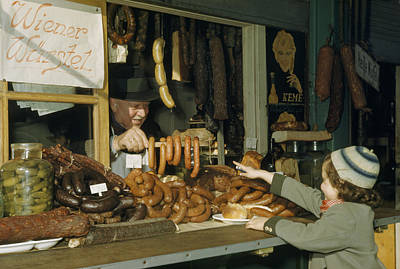 Vendor Holds Up Sausages For Young Girl Art Print by Volkmar Wentzel