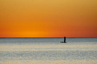 Images Of Ocean Canoes Photograph - Vezo Dugout At Sunset Near Tsifota by Pierre-Yves Babelon