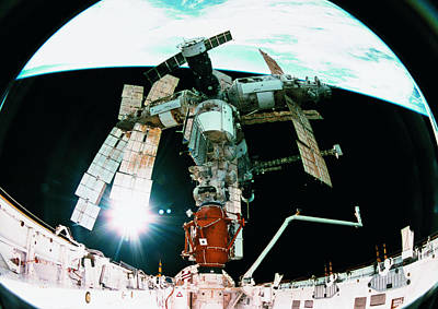 Space Ships Photograph - View From A Wide Angle Lenses Of A Space Station Docking In Orbit by Stockbyte