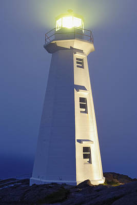 View Of Cape Spear Lighthouse In Fog Art Print by Yves Marcoux