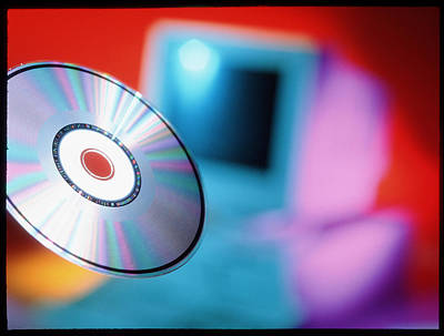 Compact Disc Photograph - View Of Cd-rom Disc In Front Of Personal Computer by Tek Image