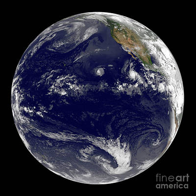 Photograph - View Of Earth Showing Three Tropical by Stocktrek Images