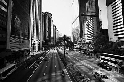 Carriageway Photograph - View Of Gloucester Road Wan Chai Canyon Like Street Surrounded By Skyscrapers Hong Kong by Joe Fox
