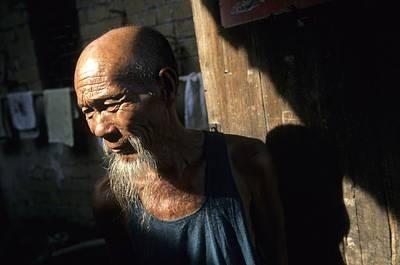 Village Elder At Doorway, Yangdi Art Print by Raymond Gehman