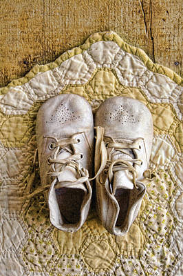 Vintage Baby Shoes On Yellow Quilt Art Print by Jill Battaglia