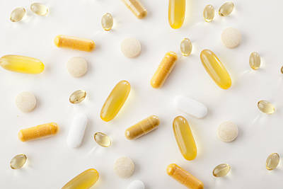 Healthcare And Medicine Photograph - Vitamins And Nutritional Supplements by Jon Larson