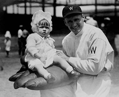 Art Print featuring the photograph Walter Johnson Holding A Baby - C 1924 by International  Images
