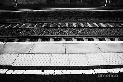 Warning Line And Textured Contoured Tiles Railway Station Platform And Track Northern Ireland Art Print by Joe Fox