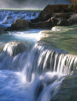 Water Flowes Over Travertine Formations Print by Bill Hatcher