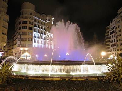 Photograph - Water Fountain Glowing At Night Valencia Spain by John Shiron
