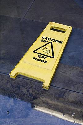 Wet Floor Sign In Puddle Art Print by Mark Williamson