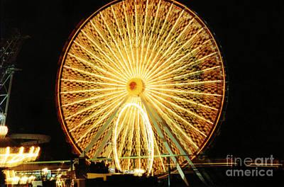 Photograph - Wheel Aglow by Susan Stevenson