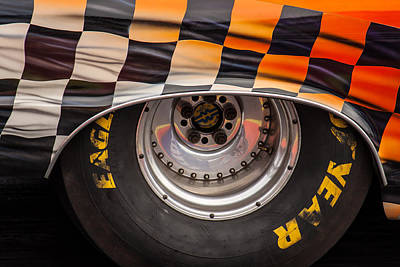 Photograph - Wheel And Chequered Flag by Ken Brannen