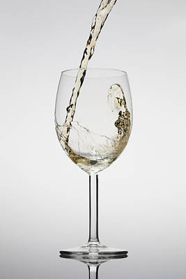 Pouring Wine Photograph - White Wine Being Poured Into A Glass by Dual Dual