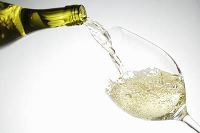 White Wine Pouring Into Glass Art Print by Brett Stevens