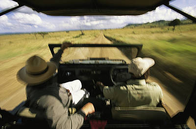 Wildlife Seekers In Jeep On Game Drive Art Print by Michael Melford