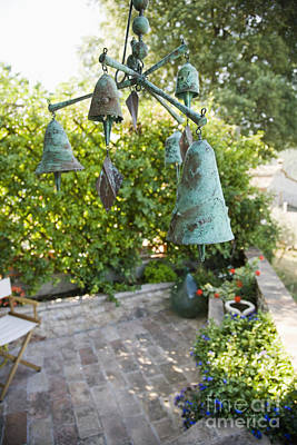 Wind Chimes Photograph - Wind Chimes In Garden by Andersen Ross