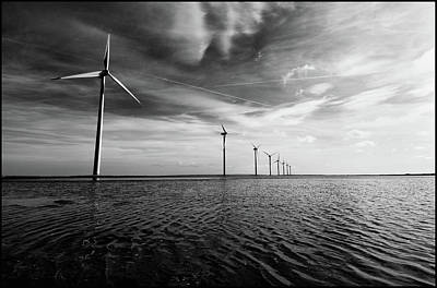 Clouds Over Sea Photograph - Windmills Out At Sea by Kenneth McNeil