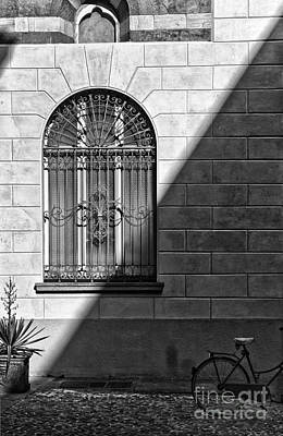 Photograph - Window And Shadow On A Wall With Bike by Silvia Ganora