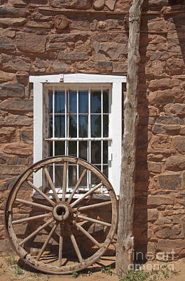 Window In Stone Building With Wagon Wheel Art Print by Thom Gourley/Flatbread Images, LLC