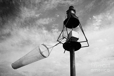 windsock flying on a harbour light mast in high winds John OGroats scotland uk Art Print by Joe Fox