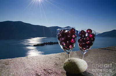 Blue Grapes Photograph - Wine Glass With Wine Grapes by Mats Silvan
