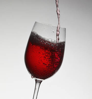 Wine Pouring Into Wine Glass Art Print by Walter Zerla