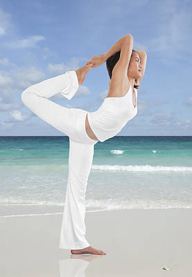 Athletes Royalty-Free and Rights-Managed Images - Woman doing yoga on the beach by Setsiri Silapasuwanchai