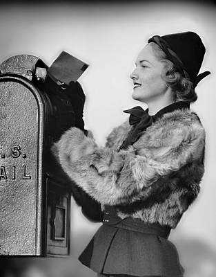 Woman Dropping Letter Into Mailbox Art Print by George Marks