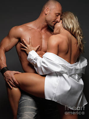 Women Together Photograph - Woman Embracing A Muscular Man by Oleksiy Maksymenko