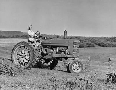 Woman Farmer Driving Tractor Art Print by George Marks