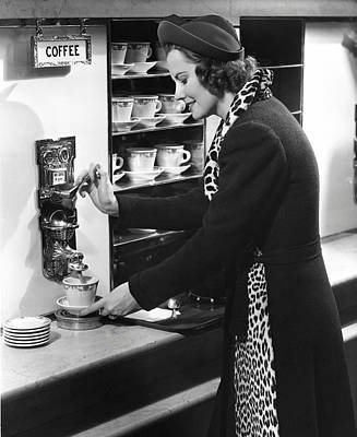 Woman Getting Coffee At Old Fashioned Machine Art Print by George Marks