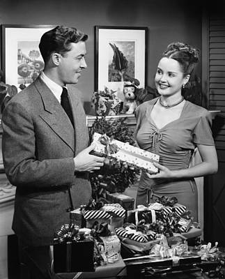 Woman Giving Gift To Man, (b&w) Art Print by George Marks