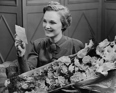 Woman Holding Flower Arrangement, Reading Card, (b&w) Art Print by George Marks