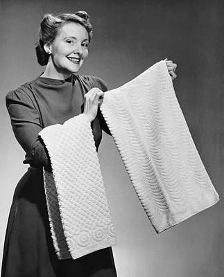 Woman Holding Up Towels Art Print by George Marks